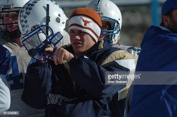 prepsplatte_canyon_bb_7 Quarterback AJ Melillop repares to practice at the Platte Canyon High School football team practice field on a snow covered...