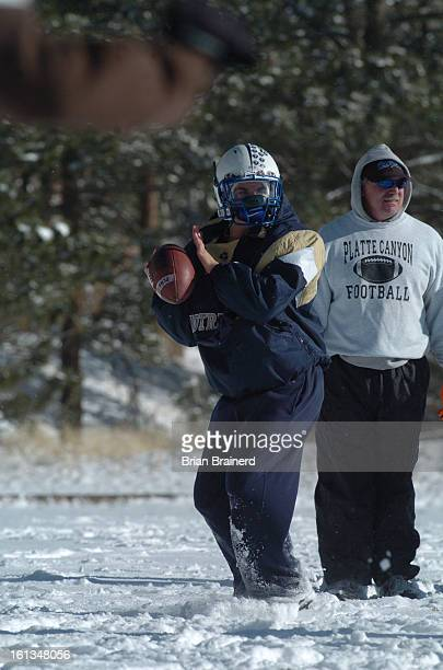 prepsplatte_canyon_bb_8 Coach Mike Schmidt and quarterback AJ Melillo during practice at the Platte Canyon High School football team practices on a...