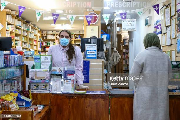 Preregistration pharmacist Miron Farmus wears personal protective equipment while working at a pharmacy in Stroud Green on April 14 2020 in London...