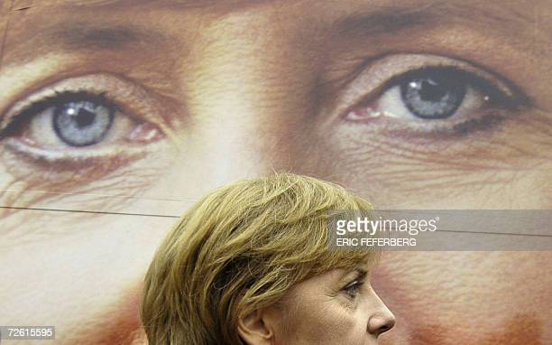 FILES Angela Merkel top candidate for Chancellor of the conservative opposition and leader of the Christian Democratic Union walks past an election...