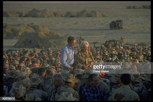 Pres Barbara Bush atop crowd of gulf crisisduty 1st Marine Division desert command post marines w Hill ldrs Mitchell Foley