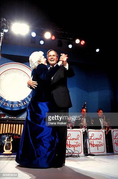 Pres. & Barbara Bush dancing together at inaugural ball.