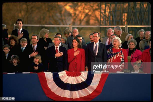 Pres Barbara Bush in inaugural stands w VP Marilyn Quayle Bush progeny incl sons George Marvin their families