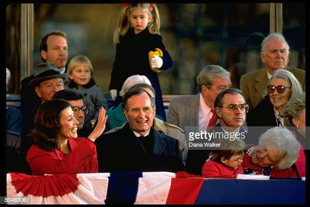 Pres Barbara Bush in stands w granddaughter Ellie LeBlond on B's lap Marilyn Quayle at Lincoln Memorial inaugural opening ceremony