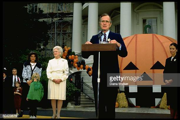 Pres Barbara Bush officiating at WH Halloween fete flanked by Marilyn Quayle daughterinlaw Margaret granddaughter Marshall