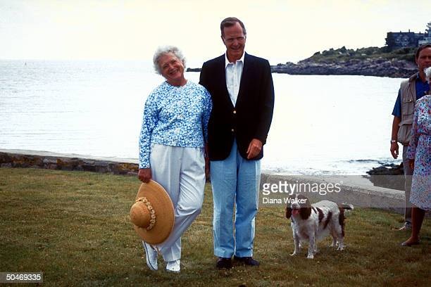 Pres Barbara Bush poised by water's edge countrycasual w 1st dog in tow