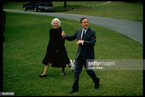 Pres Barbara Bush w family dog Millie walking on WH lawn leaving for Camp David