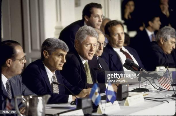 Pres. Bill Clinton at IMF event, flanked by Treasury Secy. Robert Rubin & Federal Reserve chmn. Alan Greenspan .
