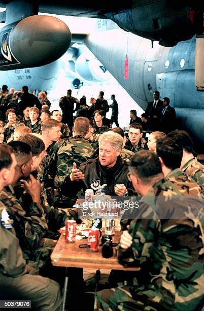 Pres Bill Clinton dining w US airmen in base mess during visit to Ramstein AFB