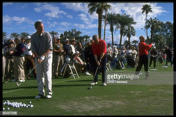 Pres Bill Clinton flanked by predecessors George Bush Gerald Ford out on course joining in Bob Hope Chrysler Classic golf tournament