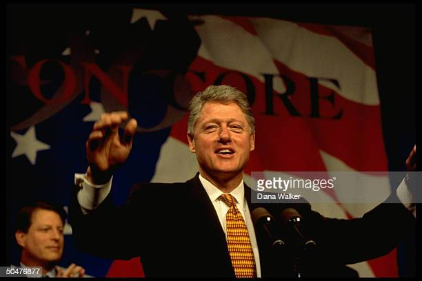 Pres Bill Clinton giving enthused speech at Clinton/Gore 1996 campaign fundraiser rally w VP Al Gore in bkgrd