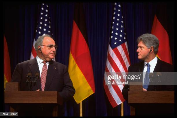 Pres Bill Clinton holding joint press conference w German Chancellor Helmut Kohl at White House