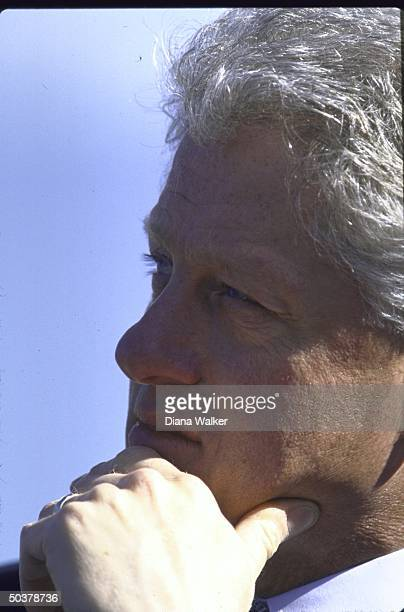 Pres. Bill Clinton in pensive portrait during visit to Barksdale AFB.