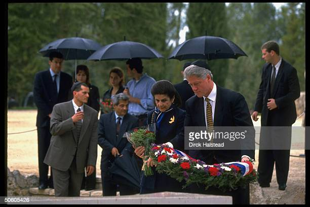 US Pres Bill Clinton w Yitzhak Rabin's widow Leah laying wreath at slain PM's grave paying respects while visiting re terror peace