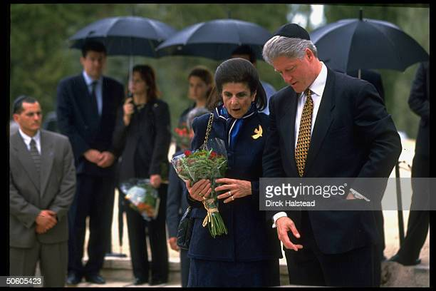 US Pres Bill Clinton w Yitzhak Rabin's widow Leah visiting slain PM's grave paying respects while visiting re terror peace