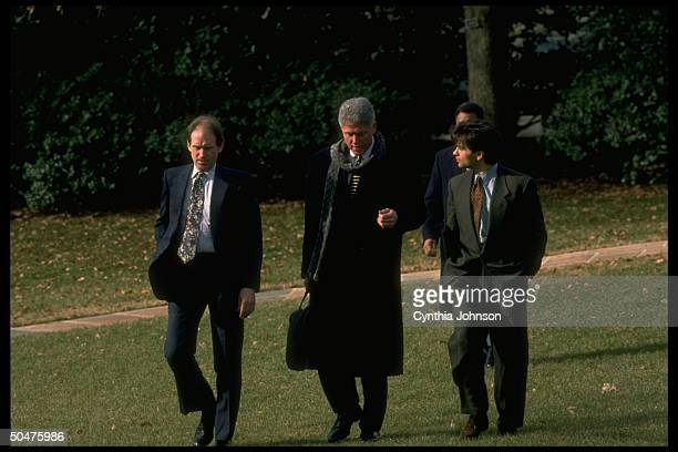 Pres. Bill Clinton walking w. Aides Harold Ickes & George Stephanopoulos, leaving White House to attend funeral.
