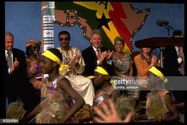 US Pres Bill Hillary Rodham Clinton w their host Ghanian Pres Jerry Rawlings wife during arrival fete at start of his African tour