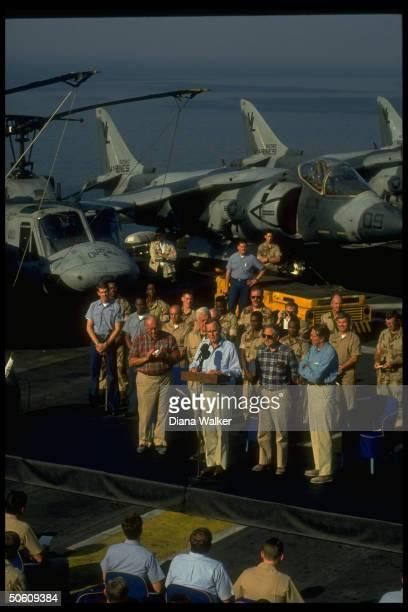 Pres Bush addressing crew on bd USS Nassau w Hill ldrs Dole Mitchell Foley Michel on gulf crisis call in Persian Gulf off coast of Saudi Arabia