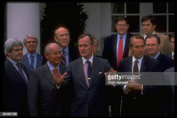 Pres Bush amid Hill crowd Gingrich Lewis Michel Simpson Dole Armstrong McCollum w WH aide Sununu in WH Rose Garden