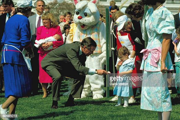 Pres Bush bending playing egg w grandkid Ellie w WH Easter invitees incl daughterinlaw Sharon w baby Ashley actor Reeve