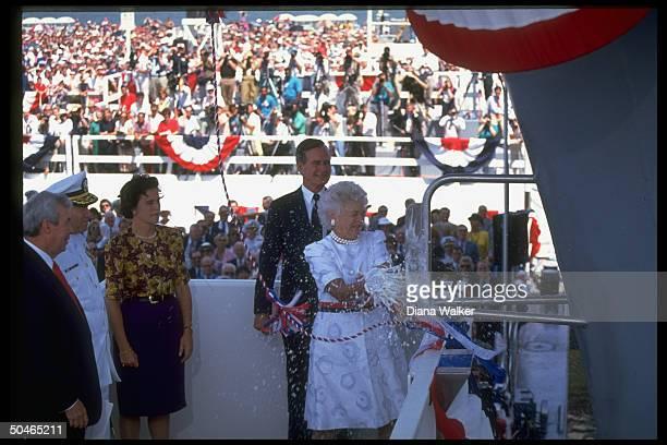 Pres Bush daughter Doro LeBlond et al watching Barbara christening USS George Washington cringing fr showering of champagne
