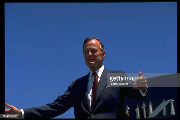 Pres Bush having high old time enjoying fresh air at Air Force Academy Falcon Stadium graduation ceremony