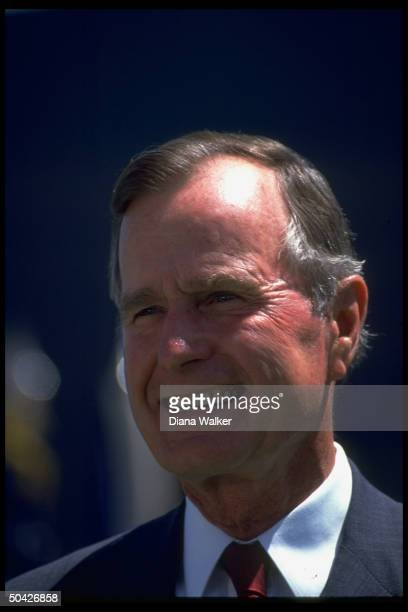 Pres Bush having high old time enjoying graduation exercises at Air Force Academy at Falcon Stadium in Colorado Springs CO