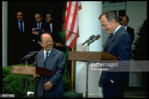 Pres Bush Japanese PM Kiichi Miyazawa speaking in WH Rose Garden before leaving for Camp David w Nick Brady Amb Armacost state secy Baker