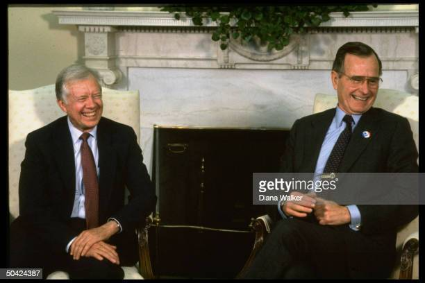 Pres Bush laughing it up w former Pres Jimmy Carter seated mtg in front of ivyadorned Oval Office mantlepiece
