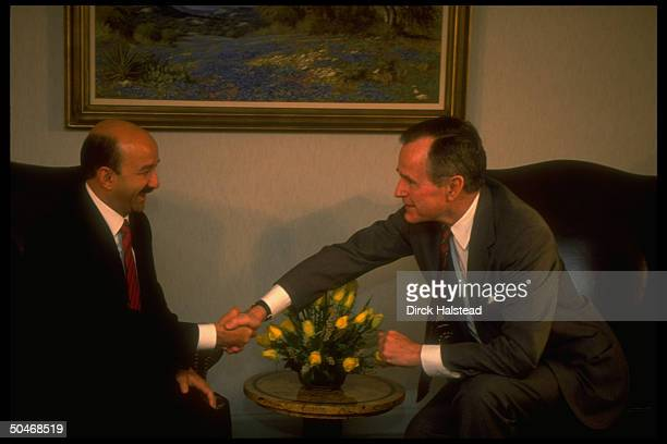 Pres. Bush reaching forward, shaking hands w. Mexican Pres. Carlos Salinas de Gortari, mtg. For private chat during drug summit w. Latin ldrs.
