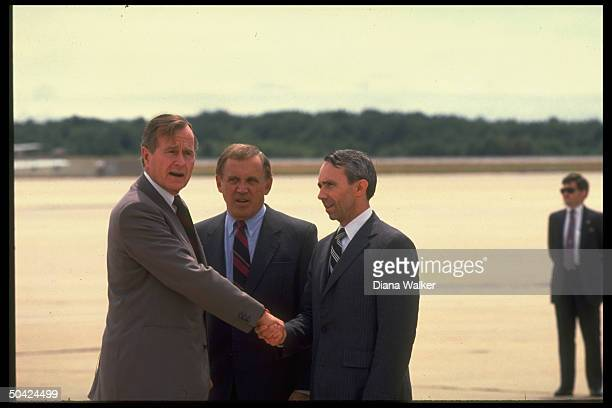 Pres. Bush shaking hands w. His Supreme Court Justice-nominee David Souter , w. Sen. Warren Rudman between them, at Pease AFB.
