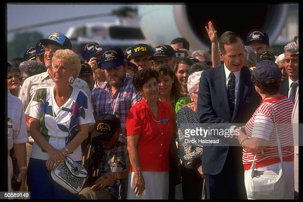 Pres. Bush shaking hands w. Some of 500 WWII vets & family fr. His USS San Jacinto VT 51 Squadron, at Andrews AFB.