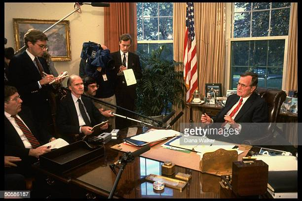 Pres Bush sitting at his desk discussing situation in Germany w NSC Adviser Scowcroft WH Chief of Staff Sununu w press on hand