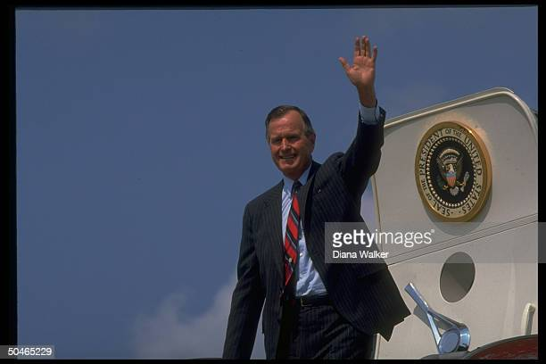 Pres Bush smiling in fine fettle pausing to wave before bding Air Force One during stop in New Orleans LA
