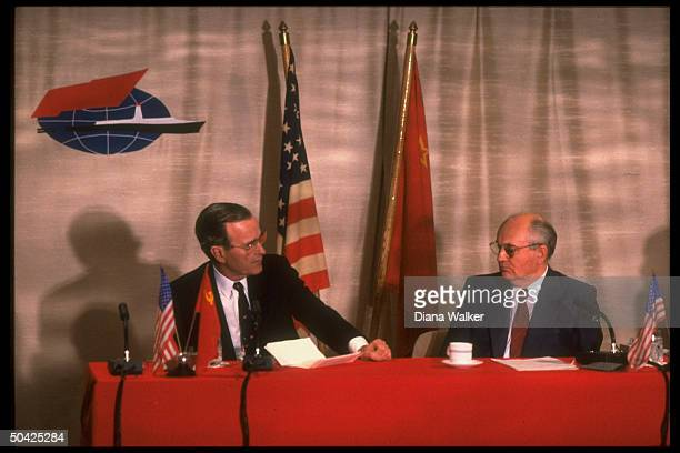 Pres Bush Soviet Pres Gorbachev facetoface looking intent holding summit press conf