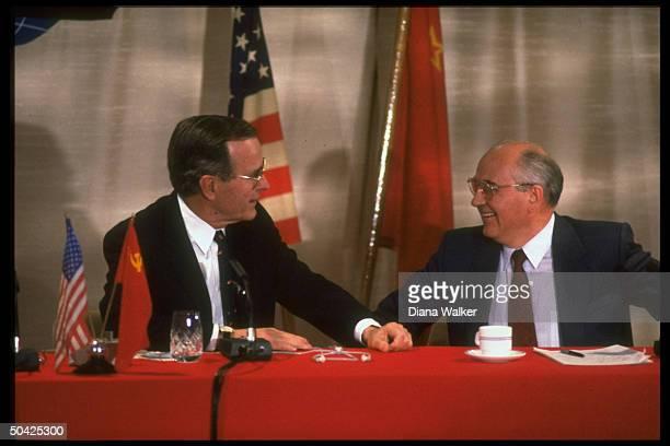 Pres Bush Soviet Pres Gorbachev sharing smile holding summit press conf
