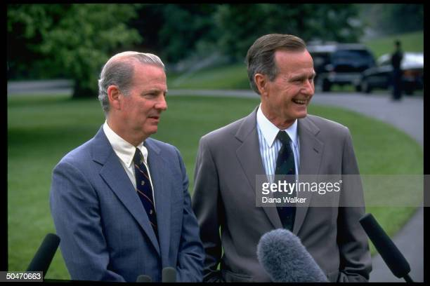 Pres Bush State Secy Jim Baker speaking to press on WH lawn leaving for Camp David