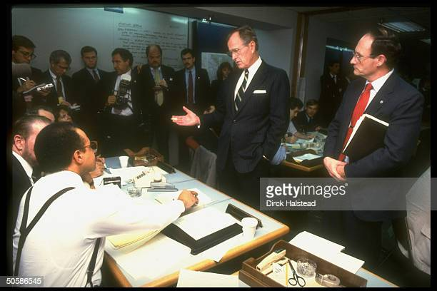 Pres Bush visiting office of emergency coordination agency FEMA questioning staffers on response to earthquake