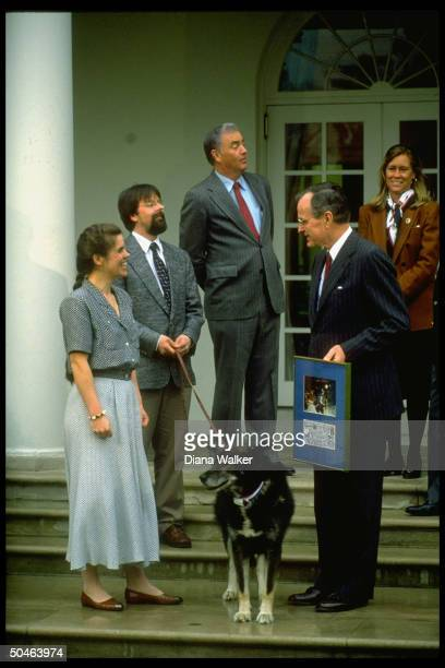 Pres Bush w dog sled racer Susan Butcher her dog Granite others incl Sen Frank Murkowski in WH Rose Garden