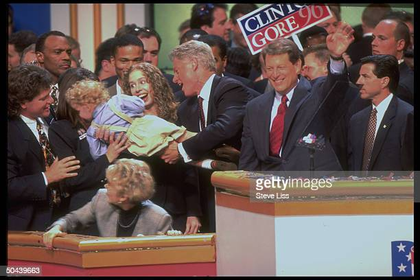 Pres Clinton handing his nephew Tyler over to parents Roger Molly w Chelsea Clinton VP Gore at Dem Natl Convention