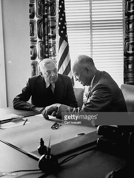Pres. Dwight D. Eisenhower and John Foster Dulles.