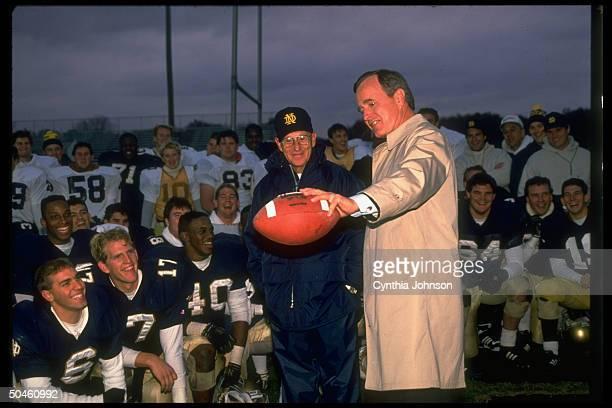 Pres. Elect George Bush, , admiring football, w. Winning Notre Dame Univ. Team & coach, Lou Holtz, .