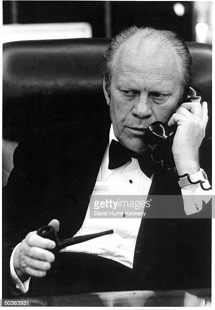 Pres Ford talking on phone to Secretary of State Henry Kissinger to get the latest from the Gulf of Thailand incident involving the freighter Mayaguez