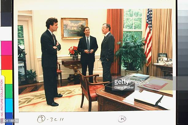 Pres George Bush w son Marvin Bush Marvin's brotherinlaw Pierce O'Neill during surprise visit to Oval Office