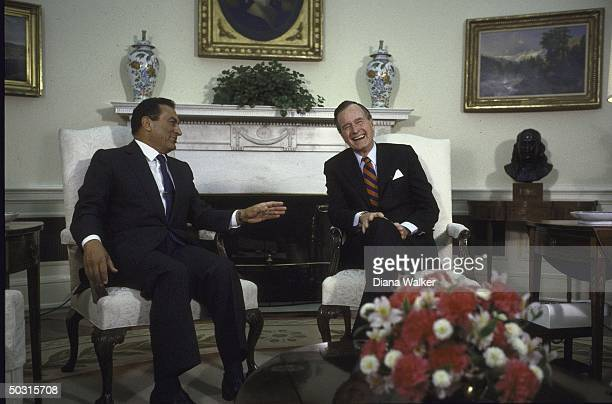 Pres. George H. W. Bush having a light moment with Egyption Pres. Husni Mubarak in Oval Office.