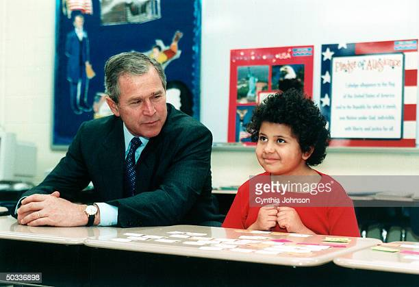 Pres George W Bush chatting up second grader at Townsend Elementary School in visit promoting his education proposals