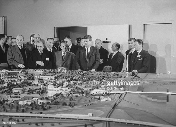 Pres John Kennedy w Norman Winston US Commission to World's Fair Robert Wagner Mayor of NYC Robert Moses World's Fair Corp Pres as they inspect a...