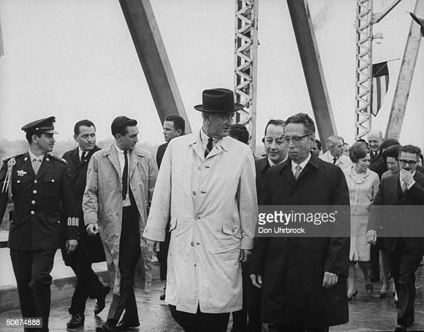 US Pres Lyndon B Johnson and Mexican Pres Gustavo Ordaz Diazdiaz meeting on bridge to inspect Amistad Dam site joint Mexico US project on Rio Grande...