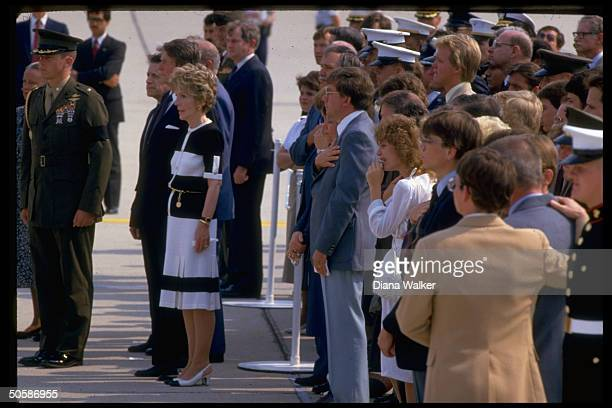 Pres Nancy Reagan Def Secy Weinberger during arrival of bodies of 4 US Marines slain by Salvadoran rebels at Andrews AFB mil ceremony