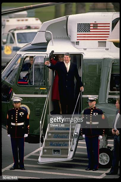 Pres Nancy Reagan pausing to wave before boarding Marine One helicopter upon their final departure fr WH after 8 yrs in office